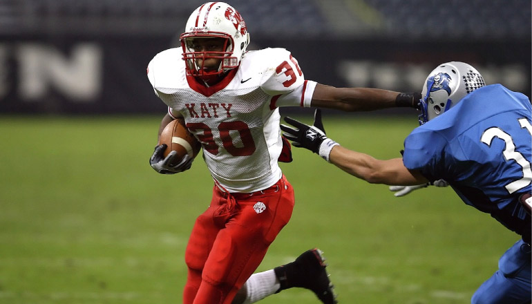 katy texas highschool football running back with dental fitted mouthguard