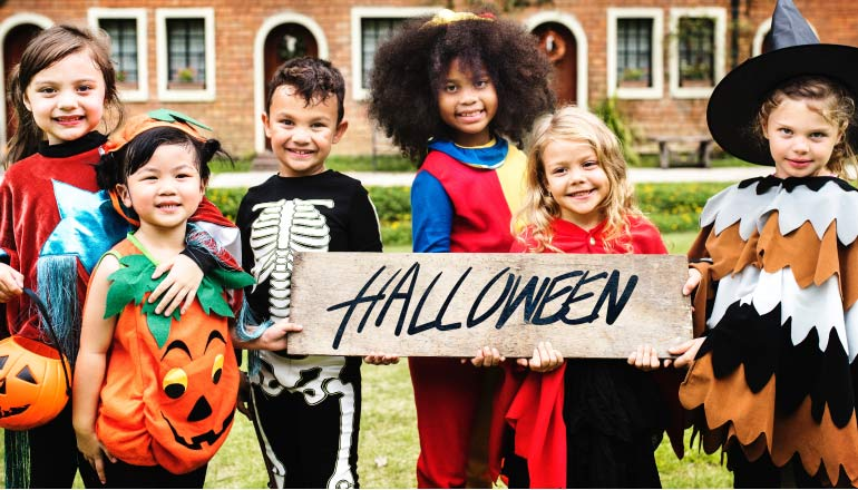 halloween trick or treaters looking for dental friendly treats