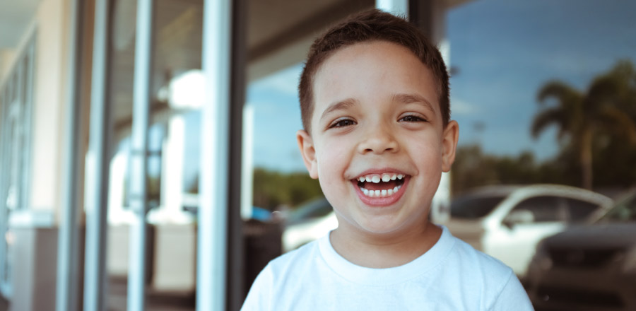 boy smiling after his orthodontic consultation